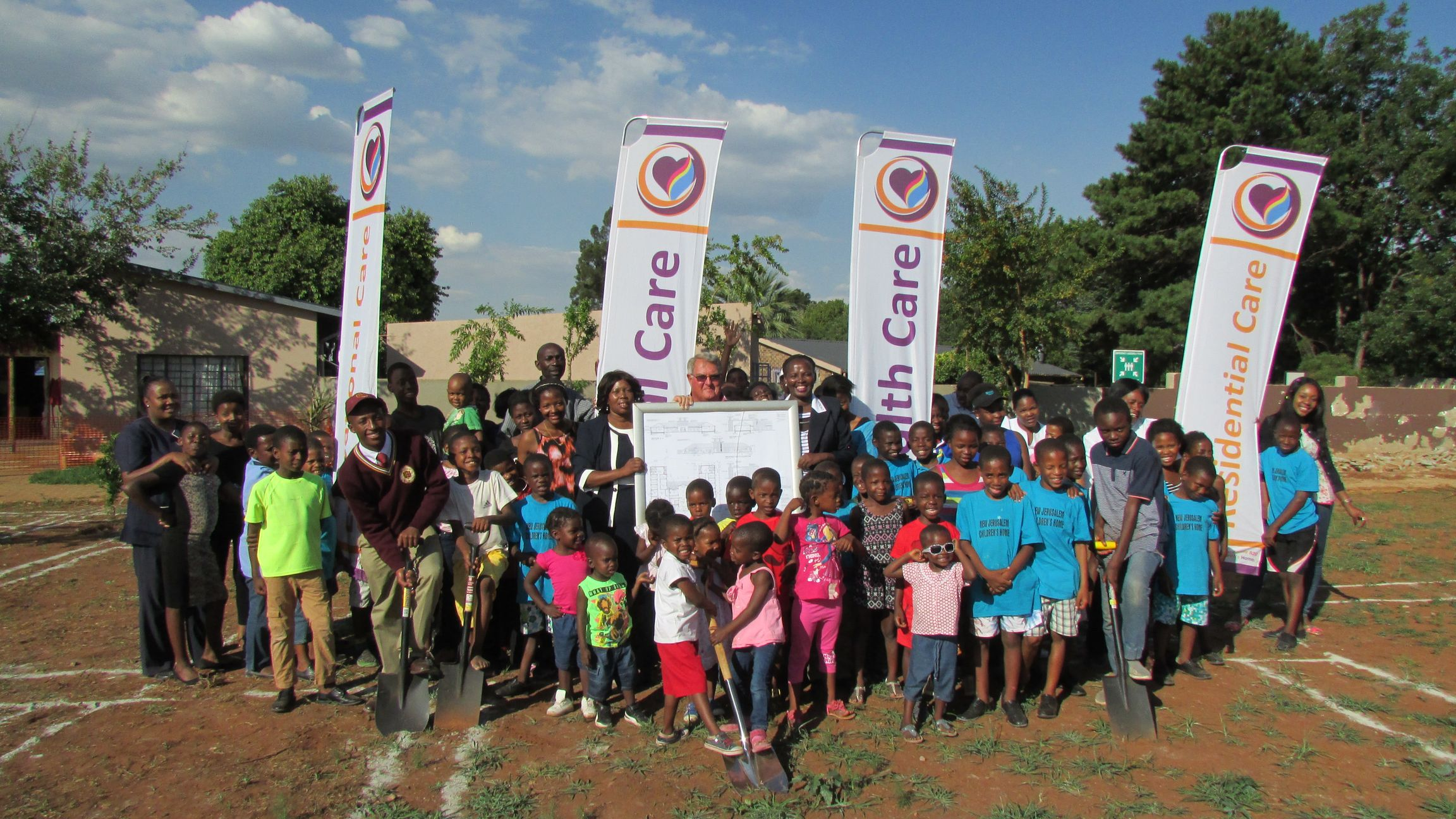Children of New Jerusalem Children's Home with Phina Mojapelo, Mr Wicus and Anna Mojapelo_CEO turning the soil