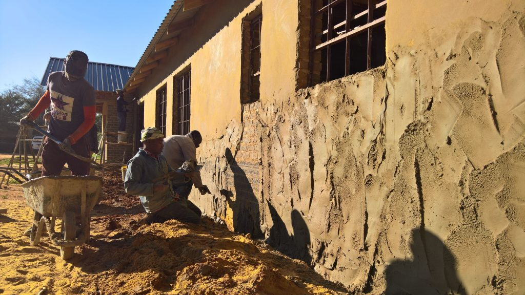 Plastering the outside walls_20