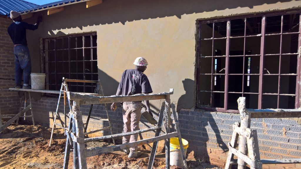 Plastering the outside walls_25
