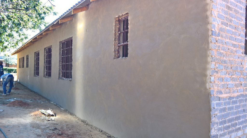 Plastering the outside walls_36
